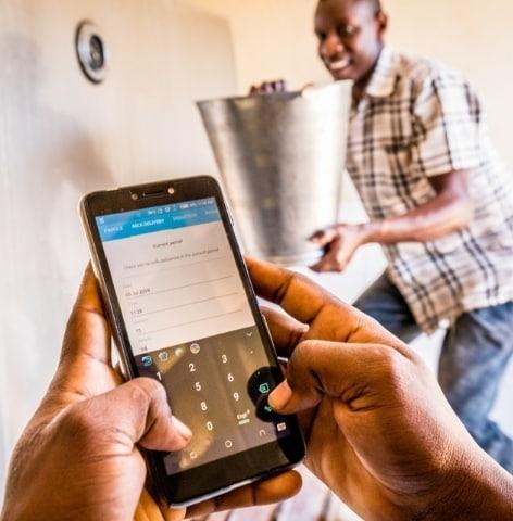 Smallholder dairy farmer is using the Emata app