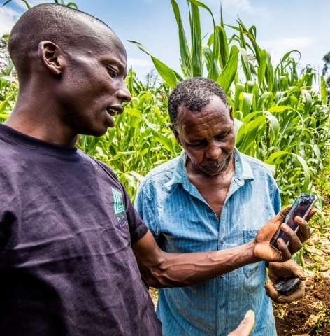 Smallholder learns more about the use of his mobile phone