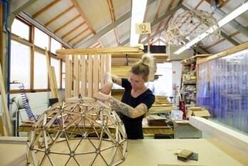 Woman making a designer lamp at Social Enterprise Binthout